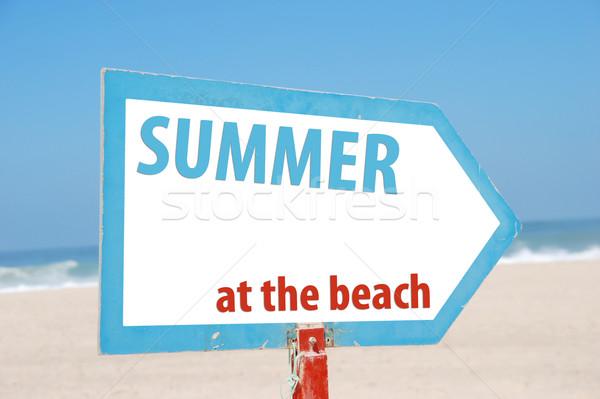 Estate spiaggia segno foto cielo blu spiaggia di sabbia Foto d'archivio © luissantos84