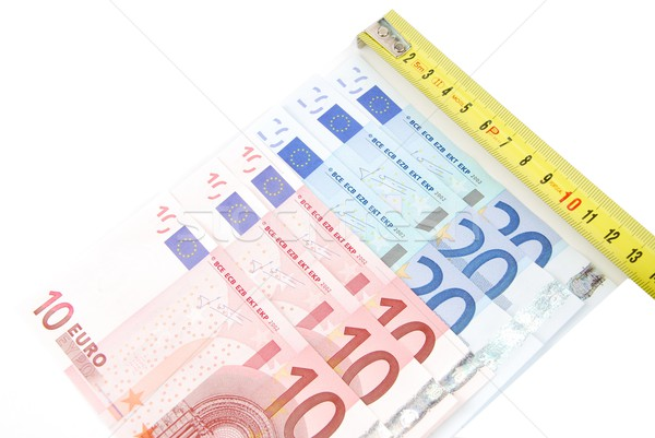 Tape measure and Euro bills (concept of financial crisis) Stock photo © luissantos84
