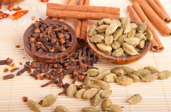 Cardamom pods and cloves Stock photo © luissantos84