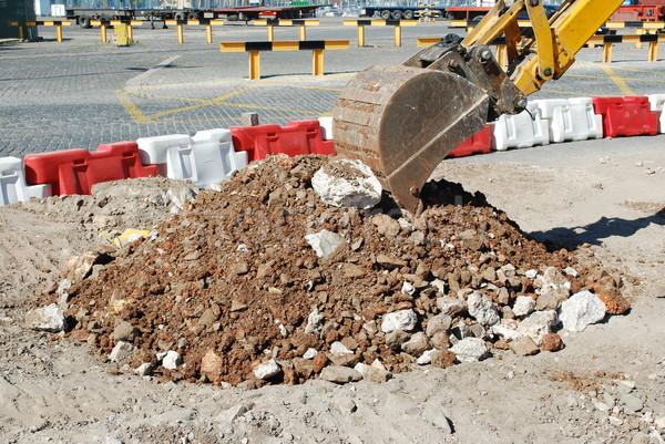 Caterpillar digging at a construction site Stock photo © luissantos84
