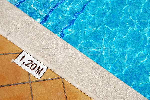 Pool depth sign at the edge of the swimming pool Stock photo © luissantos84