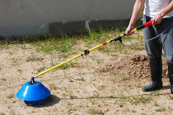 Young farmer fertilizing the soil Stock photo © luissantos84