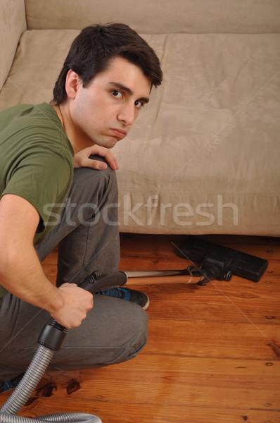 Uomo lavori di casa sfinito giovane aspirapolvere lavoro Foto d'archivio © luissantos84