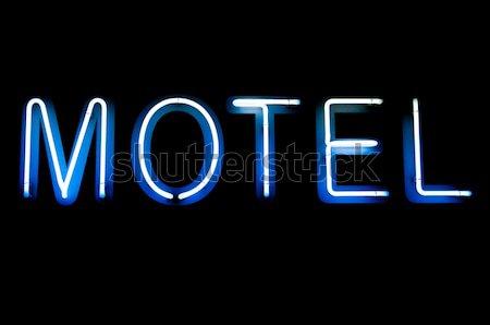 Motel teken Blauw witte neonreclame geïsoleerd Stockfoto © luissantos84