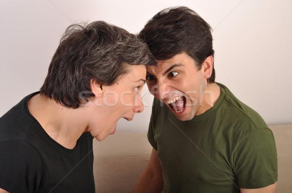 Nő férfi kiabál szemtől szembe portré pár Stock fotó © luissantos84