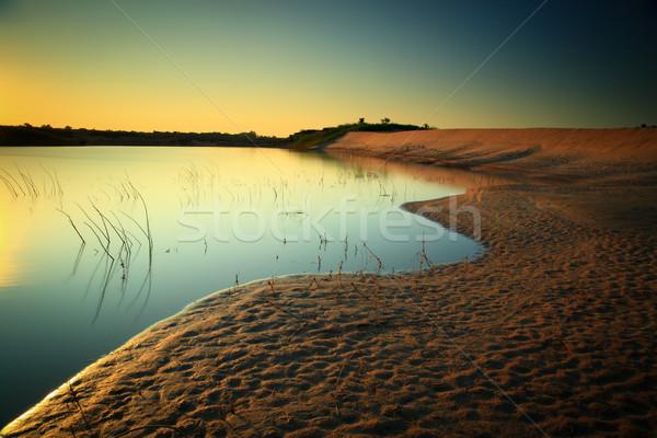 Areia lago céu pôr do sol verão azul Foto stock © lukchai