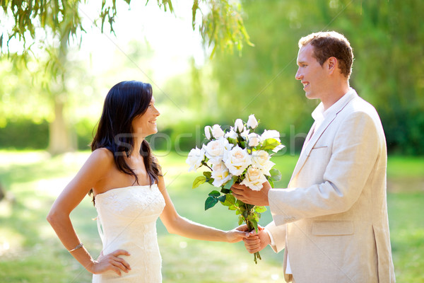 couple just married with man holding flowers Stock photo © lunamarina