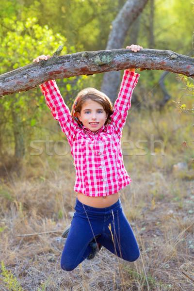 children girl swinging in a trunk in pine forest Stock photo © lunamarina