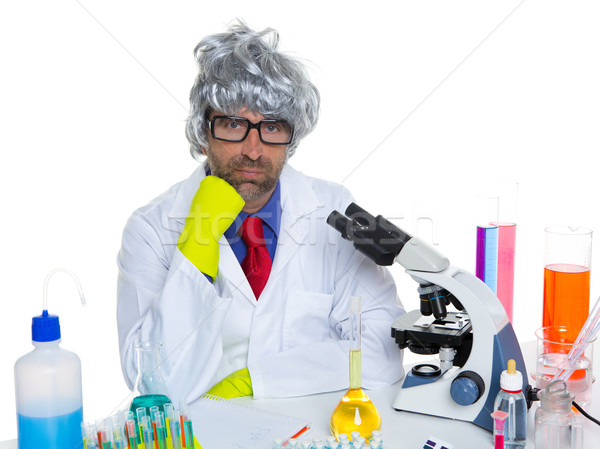 Stock photo: Carzy pensive nerd scientist at chemical laboratory