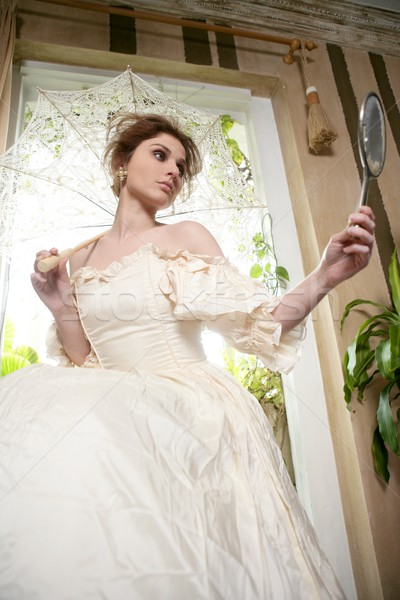 Belle femme robe blanche maison regarder main miroir Photo stock © lunamarina