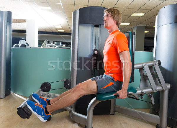 Calf extension man at gym exercise machine Stock photo © lunamarina