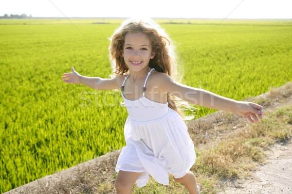 running open arms little happy girl in meadow track Stock photo © lunamarina