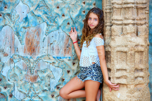 Kid girl tourist in Mediterranean old town door Stock photo © lunamarina
