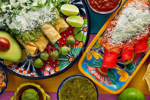 Green and red enchiladas with mexican sauces Stock photo © lunamarina