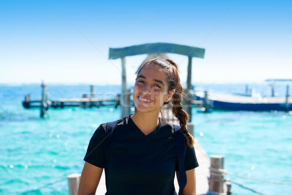 Latin young woman smiling in Caribbean pier Stock photo © lunamarina
