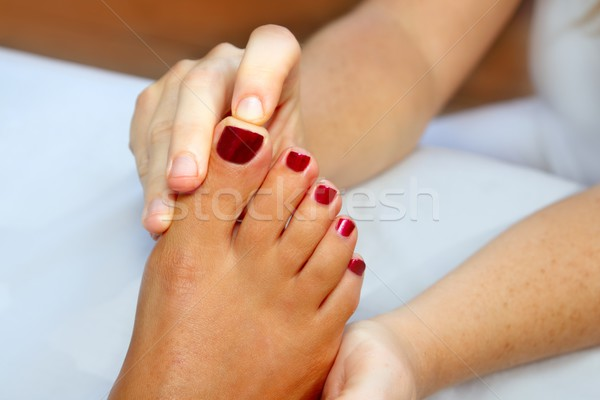 Reflexology woman feet massage therapy Stock photo © lunamarina