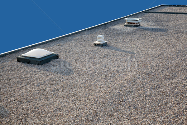 Inverted gravel roof chimney and skylight Stock photo © lunamarina