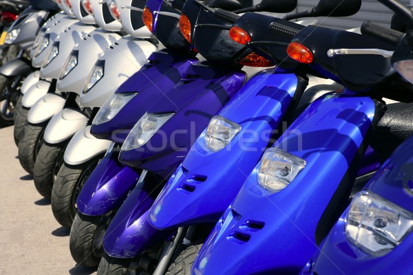 Stock photo: Scooter motorbikes in a row with perspective