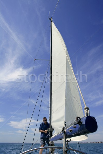 Sailor in sailboat rigging the sails Stock photo © lunamarina
