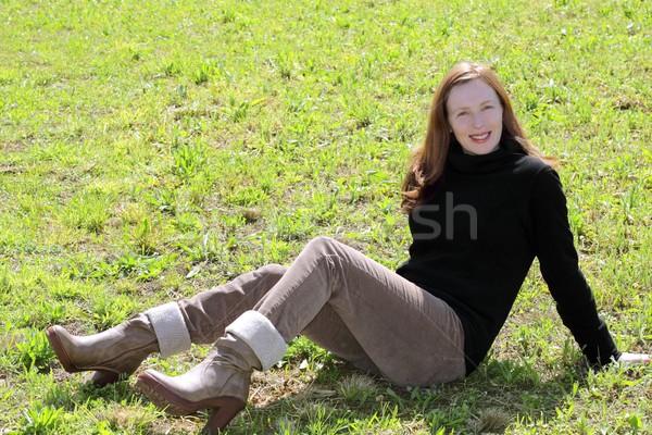 redhead woman sit meadow grass corduroy pants Stock photo © lunamarina