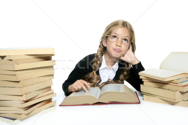 Stock photo: little thinking student blond braided girl glasses smiling
