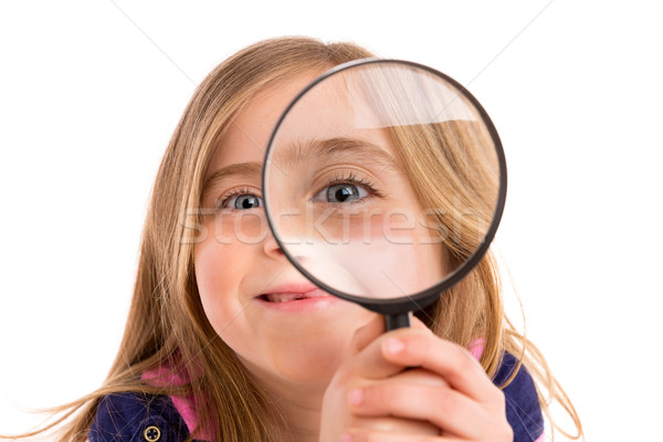 Blond indented girl with eye in magnifying glass Stock photo © lunamarina