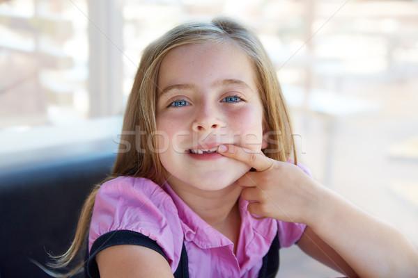 Blond happy kid girl showing her indented teeth Stock photo © lunamarina