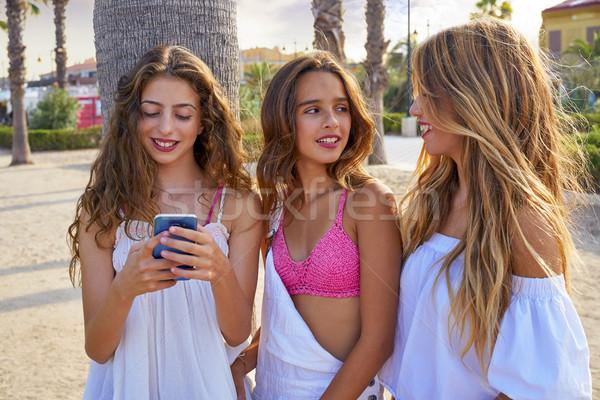 Teen best friends girls play with smartphone Stock photo © lunamarina