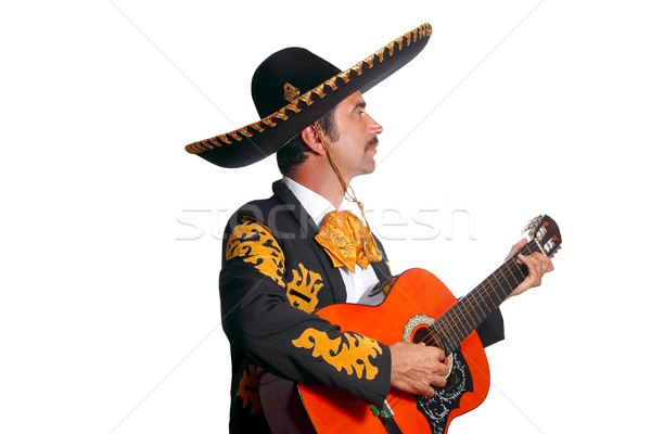 Charro mexican Mariachi playing guitar on white Stock photo © lunamarina
