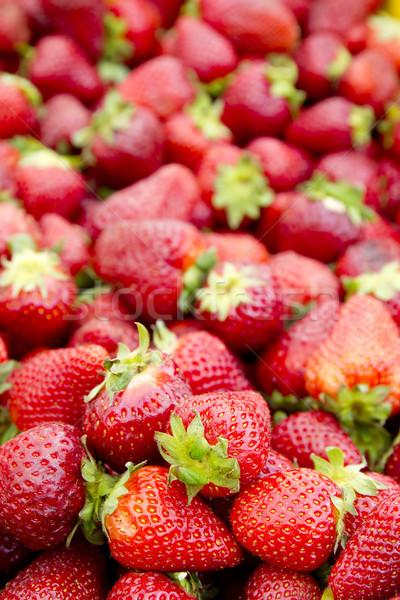 strawberries background fruits focus on foreground Stock photo © lunamarina