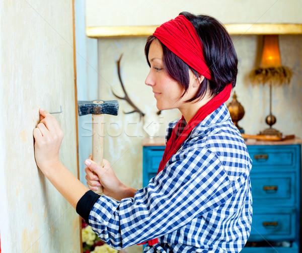 Diy fashion woman with nail and hammer Stock photo © lunamarina