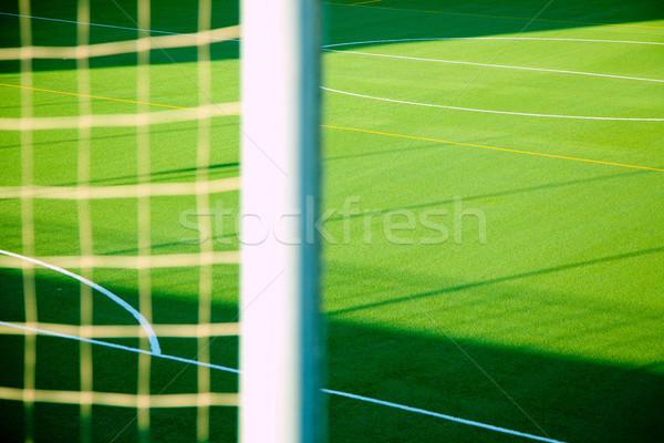 Green soccer net detail with sport grass field Stock photo © lunamarina