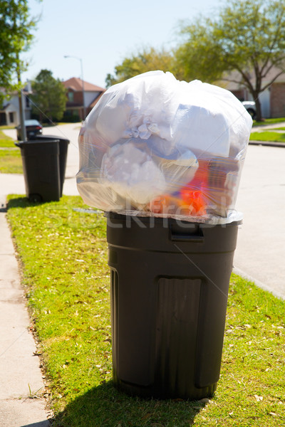 Stock photo: Trash bin dustbin full of garbage on street lawn
