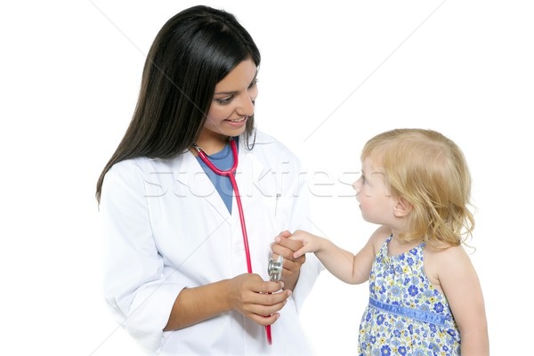 Brunette pediatric doctor with blond little girl Stock photo © lunamarina