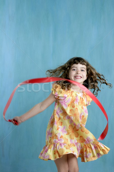 little girl red ribbon tape dancing over green  Stock photo © lunamarina