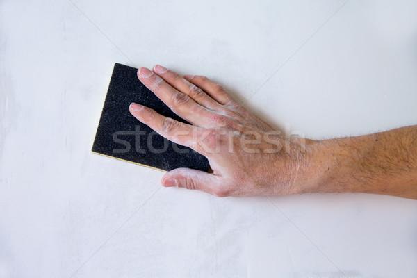 plastering man hand sanding the plaster Stock photo © lunamarina