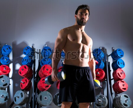 Barbell woman workout fitness in weightlifting gym Stock photo © lunamarina