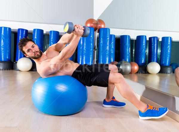 Dumbbell bench press on fit ball man workout at  gym Stock photo © lunamarina
