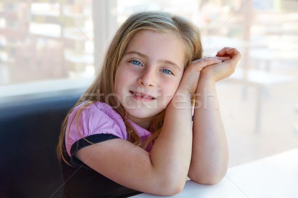 Blond relaxed happy kid girl expression blue eyes Stock photo © lunamarina