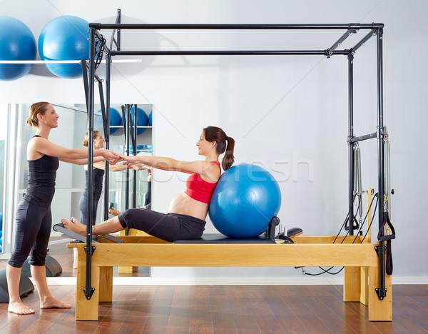 Femme enceinte pilates exercice entraînement femme Photo stock © lunamarina