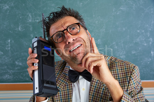 Nerd silly private investigator retro walkie talkie Stock photo © lunamarina