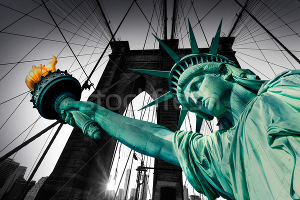 Liberty Statue and Brooklyn bridge New York Stock photo © lunamarina