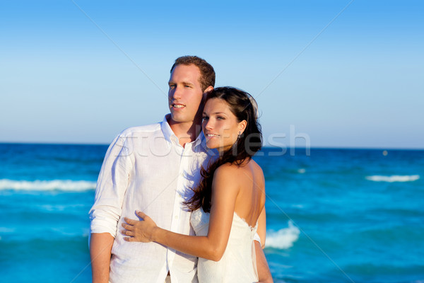 Stock photo: couple in love hug in blue sea vacation