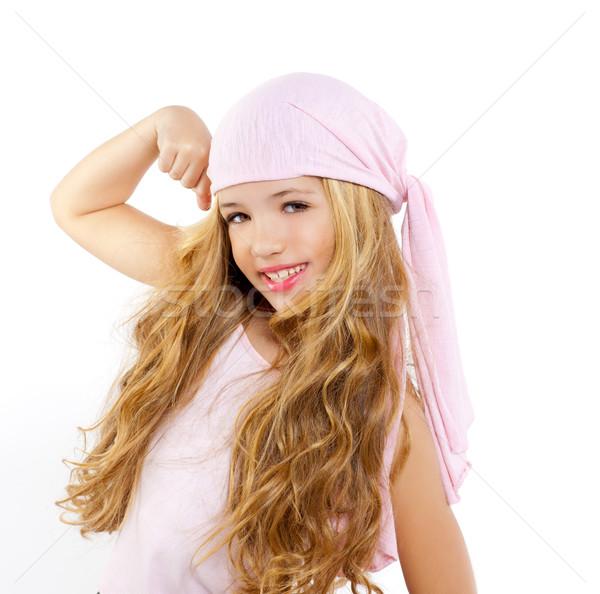 Gyerek lány kalóz zsebkendő mutat bicepsz Stock fotó © lunamarina