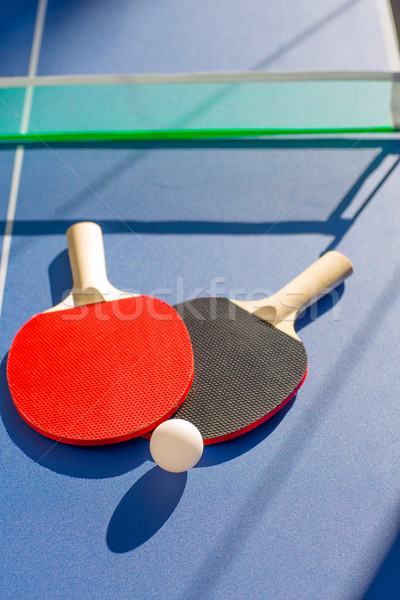 table tennis ping pong two paddles and white ball Stock photo © lunamarina