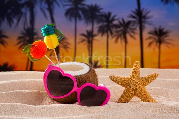 Coconut cocktail on tropical  sand beach heart sunglasses Stock photo © lunamarina