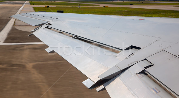aircraft plane wing taking off on airport Stock photo © lunamarina