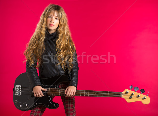 Blond Rock and roll girl with bass guitar on red Stock photo © lunamarina
