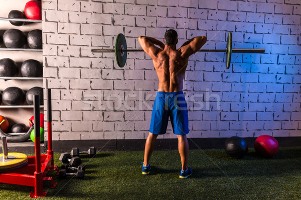 Stock photo: Barbell weight lifting man rear view workout gym