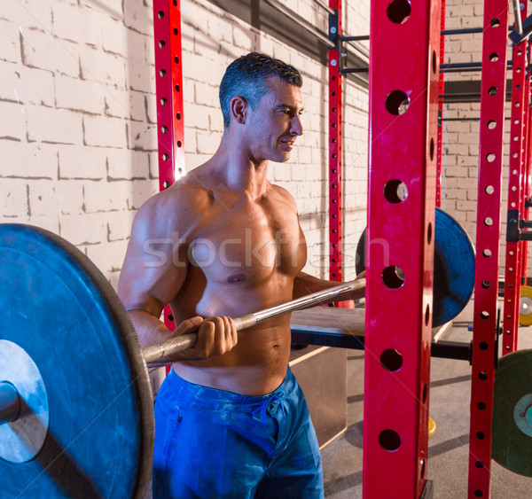 Barbell weight lifting man weightlifting at gym Stock photo © lunamarina